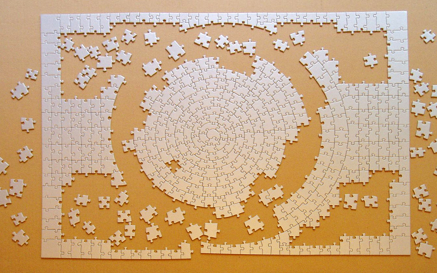 Photograph of a blank jigsaw puzzle where pieces differ only by shape.