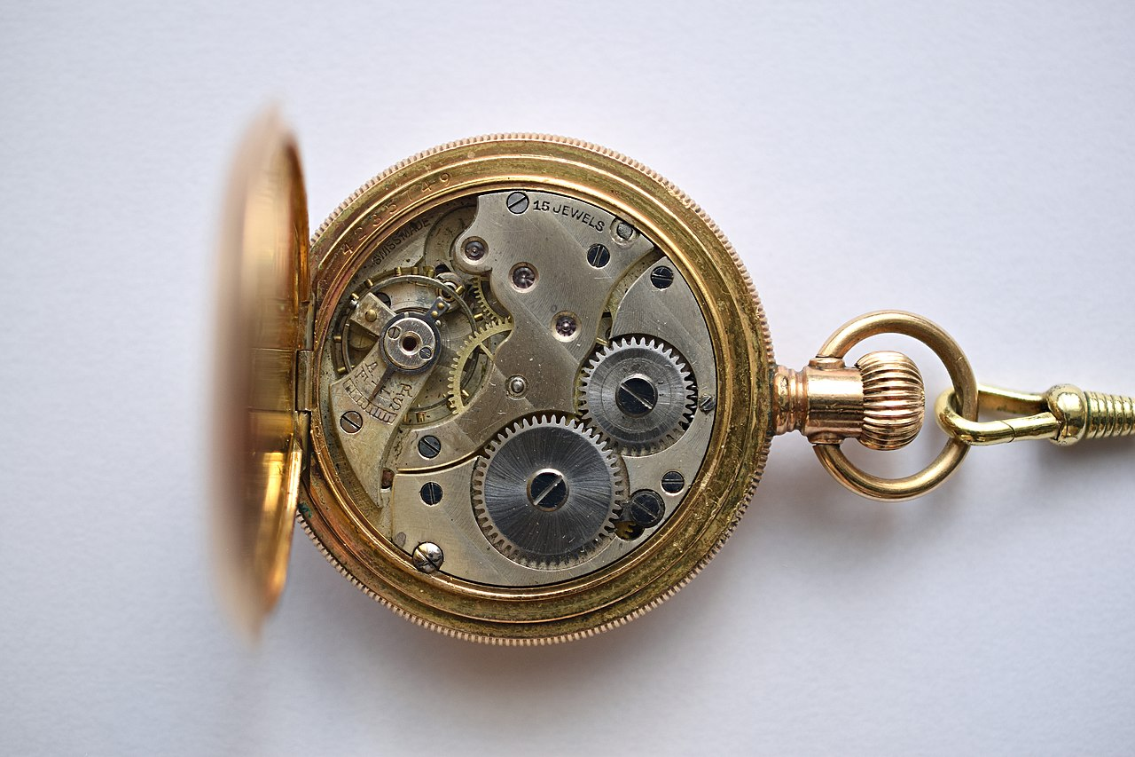 Photograph of the interior of a pocket watch showing intricate gears and fine craftsmanship.